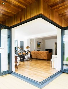 Glazed doors lead into the music room Extension - Housebuilding Dormer Bungalow, Modern Bungalow House, Mcm House, Bungalow Ideas, Bungalow Extensions, House Extensions, House Extension Design, House Design, Extension Ideas