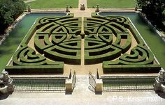 The Moated box Parterre of Chateau de la Gaude, at Les Pinichats near Aix-en-Provence, was designed by Charles Albert Pisani in about 1750.