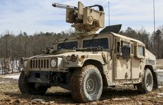 A 82nd Airborne Division Humvee armed with a Common Remotely Operated Weapons Station II provides support by fire for maneuvering Paratroopers during the Infantry Platoon Battle Course on Fort Pickett, Virginia, Feb. 25, 2015.