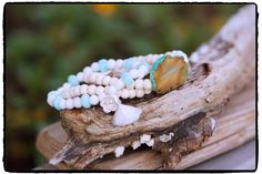 Ultra Feminine 6mm White Tridacna and 8mm Peruvian Opal Stretch Bracelet with Hill Tribe Silver Flower Charm and Tiny White Tassel by ShortDogJewelry on Etsy