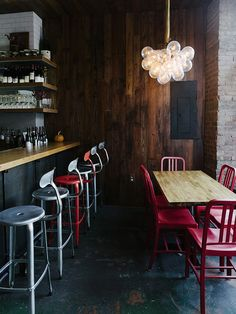 red chairs. reclaimed wood walls. subway tile.