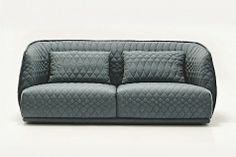 Italian furniture manufacturer Moroso's sofa Redondo, designed by Patricia Urquiola 2010 with a unique quilt pattern.