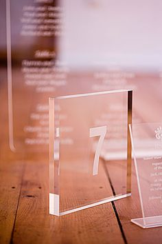 table numbers and names Wedding Table Numbers, Wedding Seating, Wedding Reception, Wedding Ideas, Trade Show Design, Modern Wedding Flowers, Event Signage, Acrylic Table, Reception Design