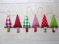 This is a fabric christmas tree garland in the colours green red and white. The christmas bunting has six christmas trees. Size of each christmas Fabric Christmas Trees, Christmas Tree Garland, Christmas Decorations, Xmas Tree, Tree Decorations, Tree Tree, Christmas Sewing, Christmas Holidays, White Christmas