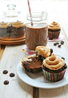 Grain-free Triple Chocolate Cupcakes topped with a creamy peanut butter frosting! // via Nosh and Nourish