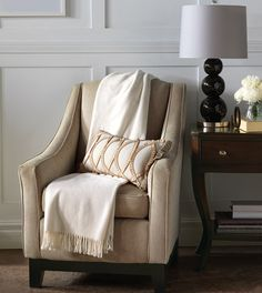 Rayland pillows by Eastern Accents. I love all the Warmth in the fabrics used not only in the pillow seen here but the throw and the chair. Earthy Bedroom, Contemporary Blankets, Amity Home, Luxury Throws, Eastern Accents, Luxury Bedding Collections, Soft Blankets, Take A Seat, Luxurious Bedrooms
