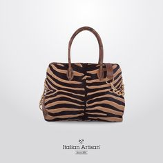 Vary the look with dual carrying handles and an attachable strap! Fully lined #madeinItaly‬ #‎leather‬ ‪#‎bag‬ with a sophisticated removable #‎pochette‬ inside. Add an animalier style to your #boutique‬ 's selection #‎handcrafted‬ #‎womensbag‬ #italianstyle‬ #b2b‬ #italianartisan‬