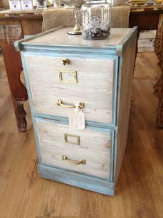 Basic wood filing cabinet .... With more of a feminine touch!