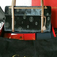 HPNWT Cartier Onyx MM Muse Logo Calfskin Purse Hard to find beautiful Cartier black furry calfskin purse, black with brown leather straps.  Never used.  Measures 11X61/2X3.  Box, dustbag, card, original receipt.  Authentic.  If interested, and need more pics, along with original receipt, I'm happy to post them as well.  Price can be negotiated!  Thanks for looking!!! Cartier Bags Shoulder Bags