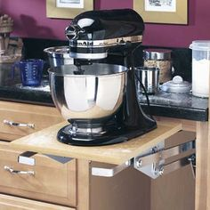 Clear counter clutter by installing a pop-out appliance lift in a base kitchen cabinet like this heavy-duty mixer lift, about $99.99, from Rockler. | Photo: Courtesy Rockler | thisoldhouse.com