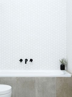 Hex tiles with concrete tiles and black tap ware, nice look