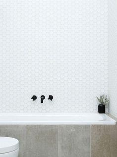 Bathroom, hexagonal tiles, concrete, and black faucet. Tile over side of tub Bathroom Renos, Laundry In Bathroom, Bathroom Interior, Modern Bathroom, Small Bathroom, Washroom, White Mosaic Bathroom, Hexagon Tile Bathroom, Minimal Bathroom