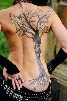 Back tree tattoo with feathers