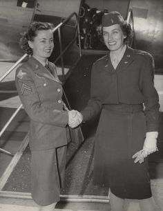 Q49360 - Member of the Women's Army Corps shaking hands with a member of the Women Airforce Service Pilots, at the bottom of an airplane ramp at Brookley Field in Mobile, Alabama. (ADAH)