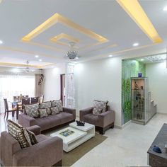 Ceilings are no longer just a roof over your head. Decor has found its way up to ceilings for a Simple False Ceiling Design, Gypsum Ceiling Design, House Ceiling Design, Ceiling Design Living Room, False Ceiling Living Room, Bedroom False Ceiling Design, Ceiling Light Design, Living Room Lighting, Living Room Designs
