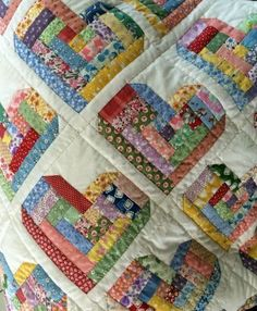 Scrappy Log Cabin Hearts Quilt. I would love to try to make this quilt.