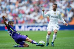 Roberto Rosales of Malaga CF competes for the ball with Jese Rodriguez of Real Madrid CF during the La Liga match between Real Madrid CF and Malaga...