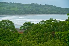 Playa Venao, Panama - Less than a five hour drive from ultra-modern Panama City, is an undeveloped, tranquil beach town — Playa Venao. Enjoy the city life if you please, then escape to soft sand, warm tidal pools, sweeping palm trees and old-time culture of Playa Venao.