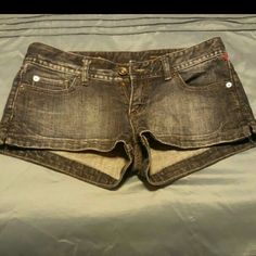 "X2 QUALITY DENIM STELLA BLING SHORTS S/4 X2 STELLA  DENIM SHORTS NWOT SIZE 4 SLITS ON THE SIDES  APPROX.:  3"" ZIPPER 98% COTTON   2% SPANDEX WAIST LAYING FLAT MEASURING ACROSS THE FRONT APPROX.:  W/151/2 INSEAM APPROX:  L/2"" FROM TOP OF SHORTS TO BOTTOM 10"" 2 SLIDE POCKETS IN THE FRONT AND A SMALL SLIDE POCKET 2 BUTTON DOWN FLAP POCKETS IN THE BACK WITH BLING SIMPLY ADORABLE JEAN SHORTS! Excellent condition X2 QUALITY DEMIN   Shorts Jean Shorts"