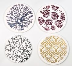 Metallic paints silk screen printed on polymer clay.