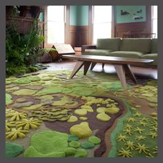 """Forest Floor Tapestry ... looks really cool, especially for any kind of groovy themed room.  """"Sparkling, delicate moss creating its own forest at the tiniest scale. Rocks draped in moss snuggle the stream. Star shaped plants that seem to have crawled from the ocean. Rich hearty soil that nourishes and holds it all together.""""  No idea on the price, but seriously, check it out ..."""