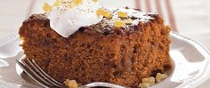 Enjoy this delicious nutty pumpkin cake made using Betty Crocker® SuperMoist® cake mix, topped with pecan mixture and whipped cream - a tasty dessert.