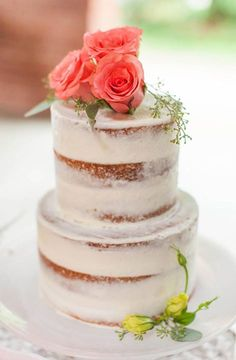 Layers of sweet cake peek through a thin coat of buttercream frosting for a dessert that looks totally homemade.  #mymaderaestates #weddingcake