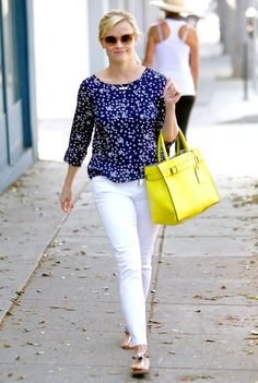 Reese Witherspoon carries a yellow bag while shopping in Santa Monica.