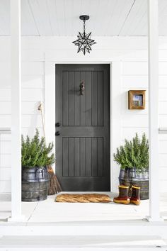 14 Front Door Colors to Boost Your Curb Appeal - Front Door Colors- Iron Gray - Dark Grey Front Door, Gray Front Door Colors, Teal Front Doors, Exterior Door Colors, Modern Front Door, Exterior Front Doors, House Front Door, Painted Front Doors, Front Door Decor
