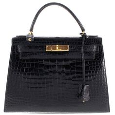 Pre-owned Kelly Bag made of crocodile leather ($18,135) ❤ liked on Polyvore featuring bags, black, heart bag, lock bag, hermes bag, heart shaped bag and hermès