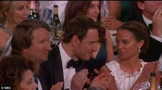Come on, just kiss him! And when his Jobs co-star Kate Winslet talked onstage about how impressive he is as an actor during her acceptance speech, Vikander rubbed his arm again