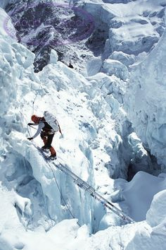 A Mountaineer Climbing Through The Khumbu Icefall On Mount Everest.