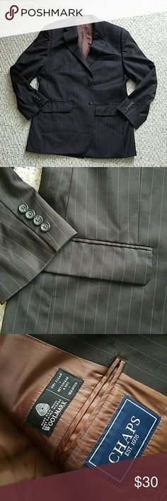 Chaps brown wool blazer Perfect condition brown woolmark blazer by Chaps. Discrete pinstripe design on the outside and silk brown interior lining as seen in photos. 100% wool inside. Let me know if there's any questions! Chaps Jackets & Coats Blazers
