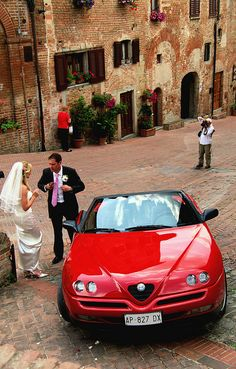 English wedding in a small Italian town. What better wedding car than an Alfa Romeo Spider