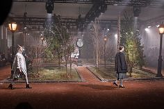 NY Fashion Week Set: The Thom Browne show re-created a wintery Washington Square Park circa 1920, with bare trees and a old-fashioned clock tower as a backdrop for top hats, tweeds, and even a toy dog on a leash.