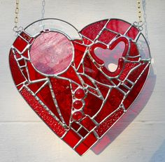 Exquisite work ;~D Stained Glass Heart Suncatcher by artophile on Etsy, $55.00