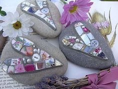 buttons, beads, shells, broken plated, then salt dough clay. just cover the pebble in it then push in the decorations