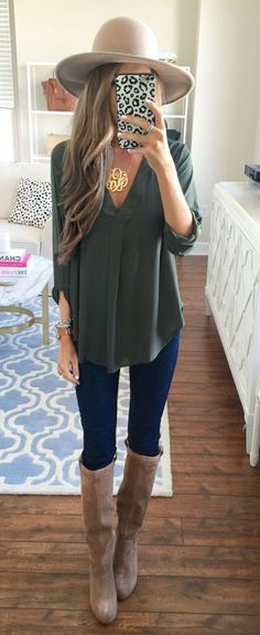 A hunter green blouse, wide brim hat and tall boots make for a perfect fall outfit!