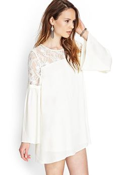 This crepe woven shift dress features a crocheted lace yoke and long bell sleeves. Complete with ...
