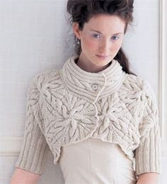 "Vogue Knitting Winter 2006/2007 #2 By Norah Gaughan This stunning multidirectional cabled shrug, which Gaughan dubs a ""capecho,"" is knit one five-cable pentagon at a time"
