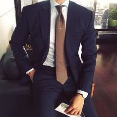 Navy Blue suit with brown tie! Perfect!