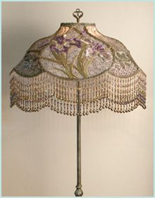 This is the Iris Garden Lamp in sold tomes of pewter, lavender, and pale sage green.