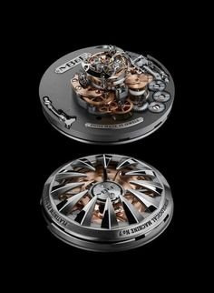 """MB&F HM7 """"Aquapod"""" - the movement of the HM7 features a winding rotor, mainspring barrel, hour and minute indicators, and flying tourbillon, all concentrically mounted around a central axis and rotating concentrically around it."""