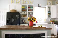 Love the chalkboard on the island (and fridge), the open shelves, and the colors.