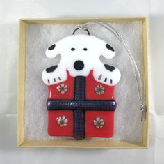 Fused Glass Christmas Ornament - Black and White Puppy Dog in a Present by LazyDogArts on Etsy https://www.etsy.com/listing/241626041/fused-glass-christmas-ornament-black-and