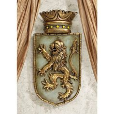 """English European Medieval Lion Shield Wall Sculpture Decor - Set of 2 by XoticBrands. $77.95. Cast in quality designer resin. The bravery and strength reflected in the lion-emblazoned crest heralding England and Scotland during the Middle Ages is celebrated in this quality designer resin exclusive. Especially impressive in pairs, whether flanking a fireplace or entryway, the crowned king of beasts is hand-painted in antique gold and ancient green.7""""Wx2½""""Dx14½""""H. 2 lbs.K..."""