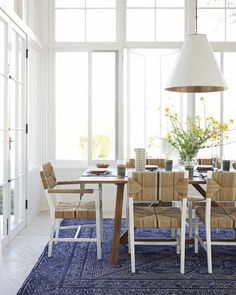 Feast Your Eyes: Gorgeous Dining Room Decorating Ideas - A brightly colored rug is a great way to liven up your dining space without having to break out a paintbrush. Adding a rug can also dramatically delineate the dining area in open-plan homes.
