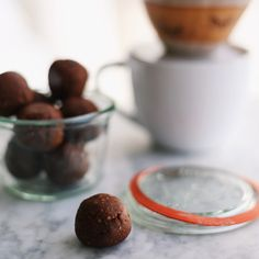 dark chocolate almond butter ball recipe - plant based + vegan bliss ball snack with raw cacao, cacao nibs, coconut flakes, and pure maple syrup