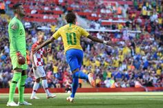 TOPSHOT - Croatia's goalkeeper Danijel Subasic (L) reacts as Brazil's striker Neymar celebrates after scoring the opening goal of the International friendly football match between Brazil and Croatia at Anfield in Liverpool on June Brazil Football Team, Football Match, Brazil World Cup, Fifa World Cup, Neymar Jr, Portugal Vs Spain, Psg, World Sports News, Match Schedule