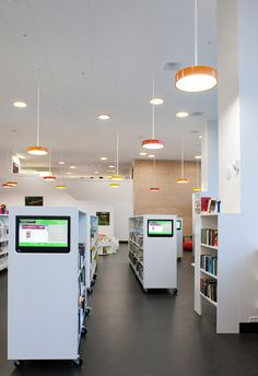 Library catalogue integrated at the end of bookcases. Orestad Skole